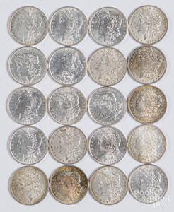 Twenty Morgan silver dollars, some uncirculated.