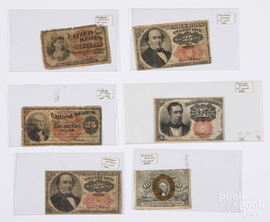 Six US fractional currency notes.