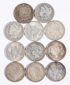 Eleven silver dollars