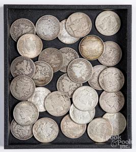 Twenty-eight silver dollars