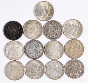 Thirteen silver dollars
