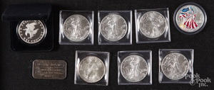 Nine 1 ozt. fine silver coins and ingots.