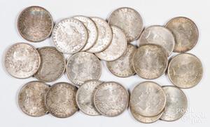 Twenty-one silver dollars