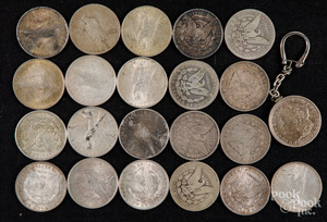 Twenty-two silver dollars