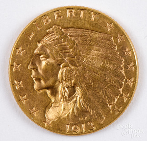 1913 Indian Head two and a half dollar gold coin.
