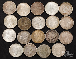 Nineteen silver dollars