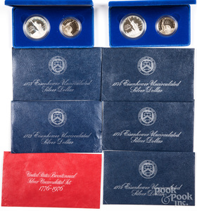 Twelve uncirculated Eisenhower silver dollars, et