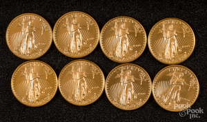 Eight 1/4 ozt. fine gold coins.