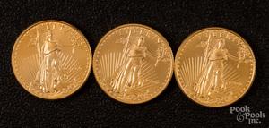 Three 1/4 ozt. fine gold coins.