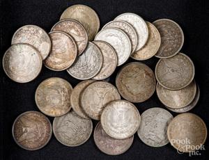 Twenty-six Morgan silver dollars.
