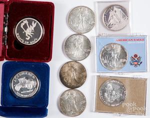 Nine 1 ozt. fine silver coins.