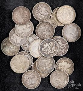 Twenty-three silver dollars