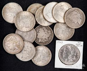 Fourteen silver dollars