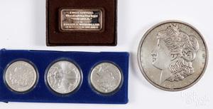 One pound Morgan silver dollar, etc.