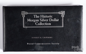 Ten silver dollars with commemorative stamps.