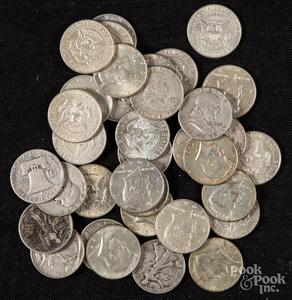 Sixteen 1964 Kennedy half dollars, etc.