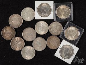 Fourteen Peace silver dollars.