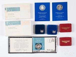 Ten silver dollars and commemorative coins.