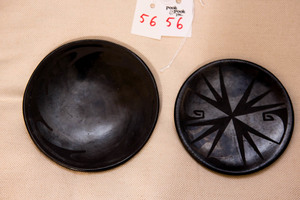 Two San Ildefonso Indian black pottery trays