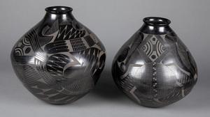 Contemporary black on black pottery vessels