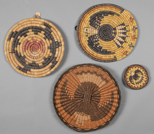 Four Hopi Indian basketry plaques, three with eag