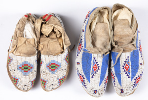 Two pairs of Sioux Indian moccasins, sinew sewn,