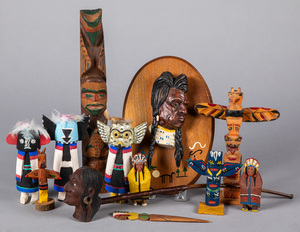 Twelve Native American Indian themed wood carving