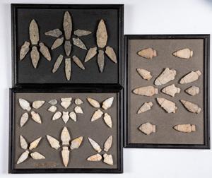 Three frames of prehistoric arrowheads