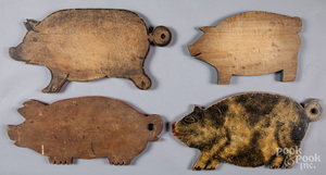 Four painted pig cutting boards