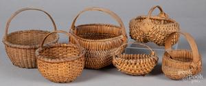 Six small woven baskets