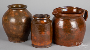 Redware pitcher, together with two crocks 19th c.