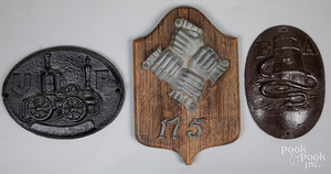 Two cast iron fire marks, etc.