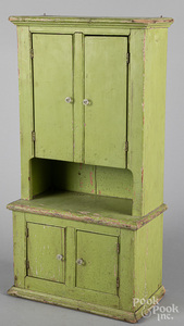 Child's painted step back doll cupboard