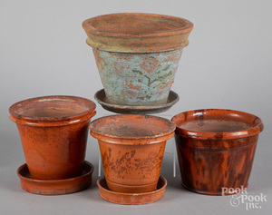 Four Pennsylvania redware flower pots, 19th c.