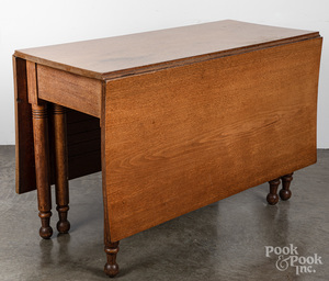 Sheraton walnut drop leaf table, 19th c.