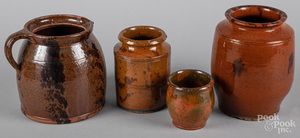 Four American redware vessels, 19th c.