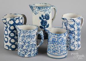 Five sponge decorated stoneware pitchers