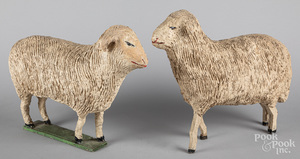 Two large carved and gessoed stick leg sheep
