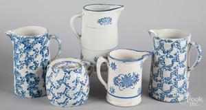 Five blue spongeware pitchers 19th c.