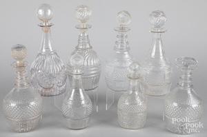 Eight colorless glass decanters, 19th c.