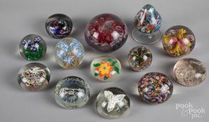 Thirteen glass paperweights