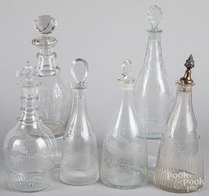 Six engraved colorless glass decanters, 19th c.
