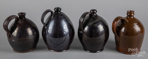Four redware jugs, 19th c.