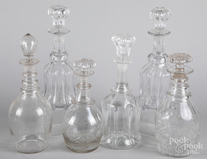 Six colorless glass decanters