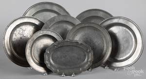 Eight pewter chargers and trays