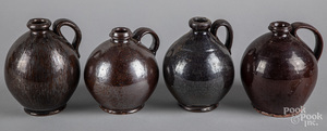 Four small redware ovoid jugs
