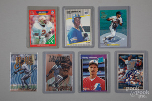 Seven baseball and football cards