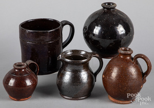 Two small redware ovoid jugs