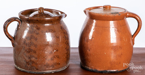 Two Pennsylvania redware lidded pitchers