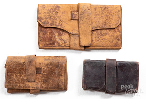Three early leather pocketbooks